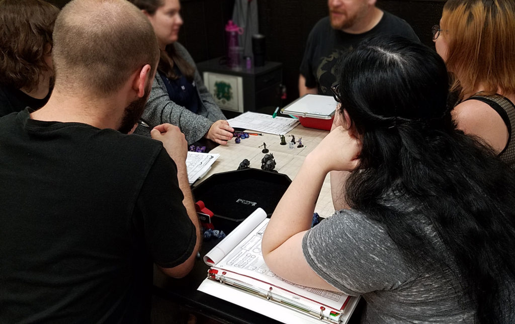 dungeons and dragons at game table cafe